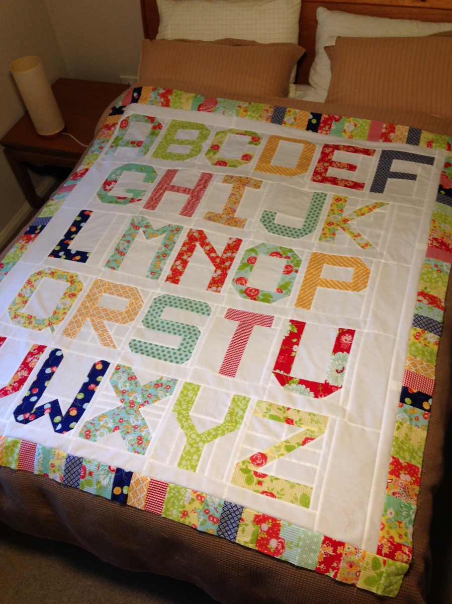 At last!  Spell it with Moda quilt top is complete